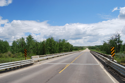 Thanks to the federal Infrastructure Stimulus Fund, the Battle River bridge is now up to current standards and will no longer require ongoing heavy maintenance. The bridge deck has been resurfaced with asphalt and metal guardrails replaced the older wooden ones.