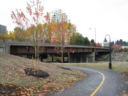The Old Capilano Bridge is replaced with a three-lane structure to relieve congestion along Marine Drive