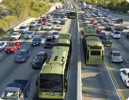 Buses and cars on a busy highway