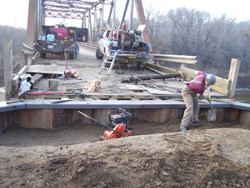 Workers replaced the wooden pilings on the two bridges with modern steel supports, reinforced the deck structure and paved the road surface