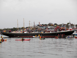 The Bluenose II, returned to her previous glory, floats in the harbour as onlookers savour this momentous event.