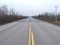 The work on Route 2 involved cold milling, excavating and patching potholes and selected areas of the road surface, and repairing and rebuilding shoulders before putting down two additional layers of asphalt