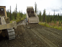 Local contractors are rebuilding the sub-grade of the gravel South McQuesten Road, refinishing its surface, clearing out ditches and brush bordering the road, and installing new culverts