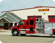 Fire truck in front of fire hall in Pouce Coupe, British Columbia