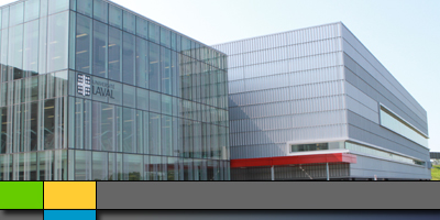 External shot of two finished buildings featuring glass, aluminum and the Laval University logo.
