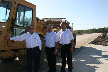 Left to right: Bill McAlpine, Mayor of Okotoks, George Groeneveld, Minister of Alberta Agriculture and Rural Development and MLA for Highwood, and Ted Menzies, Member of Parliament for Macleod and Parliamentary Secretary to the Minister of Finance.