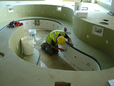 Photo: A worker completes finishing touches on the whirlpool.