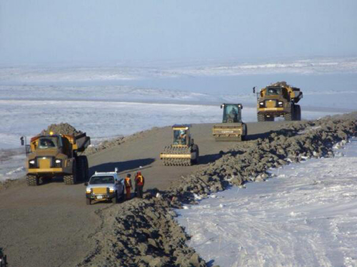 Construction vehicles on the Inuvik to Tuktoyatuk Highway