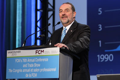 Photo of Minister Lebel addressing the Federation of Canadian Municipalities