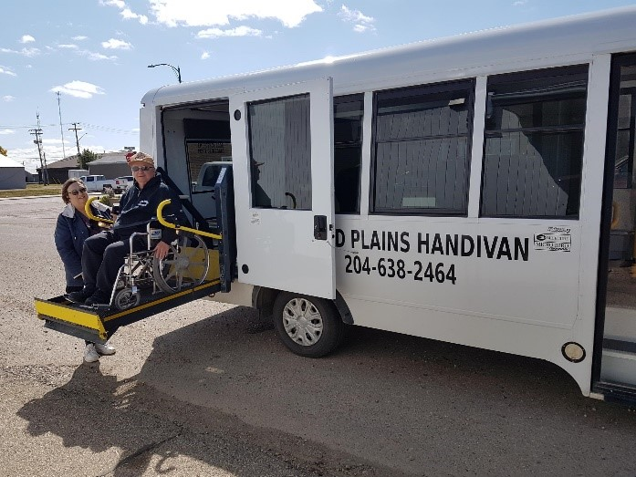 Rider getting on wheelchair accessible handivan