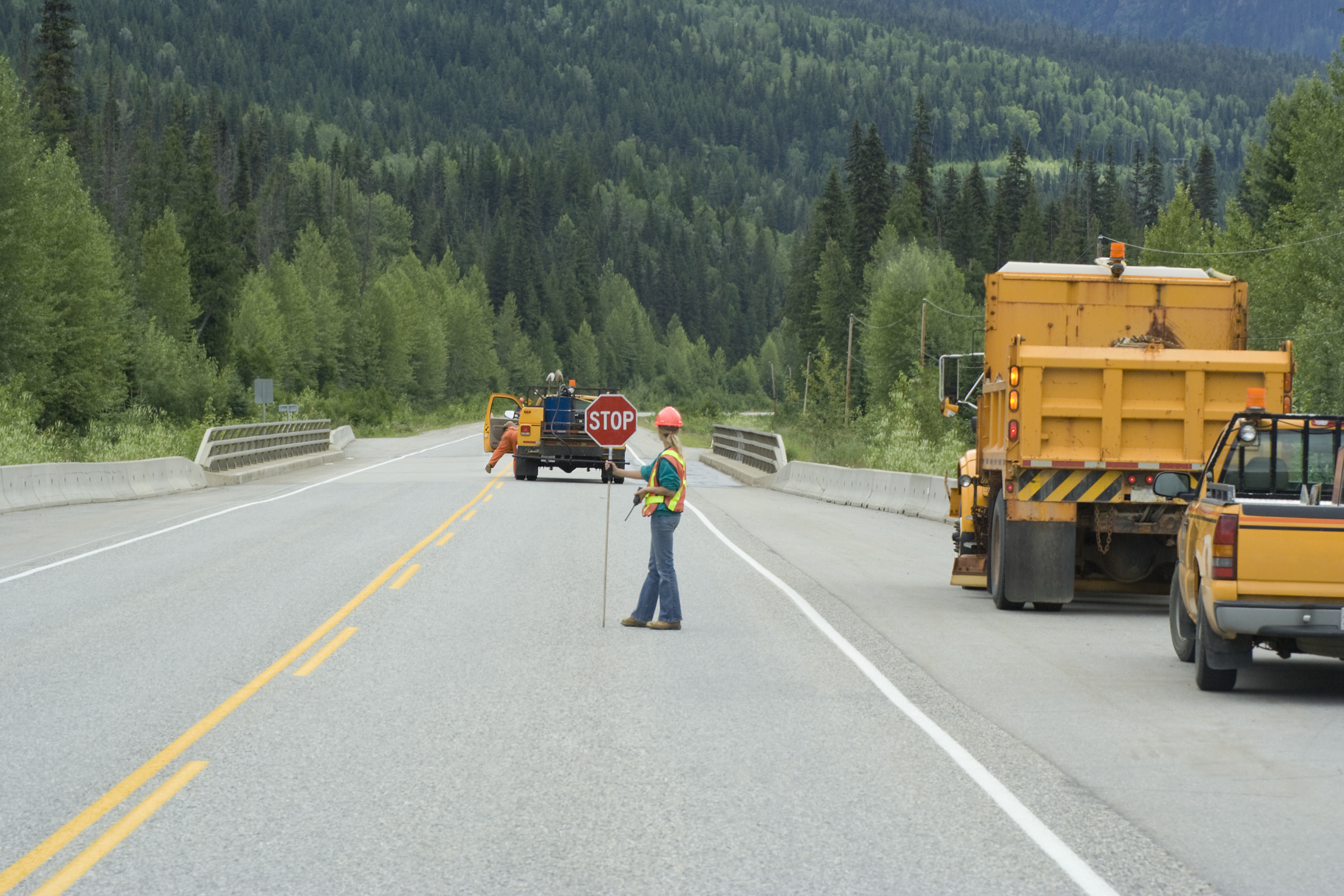 Construction workers on highway in Alberta completing roadwork